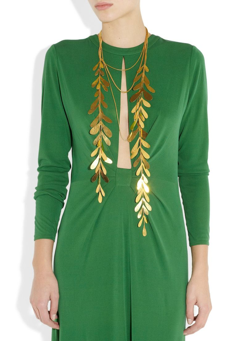 Hervé Van der Straeten. Hammered 24-karat gold-plated leaf necklace against beautiful green dress