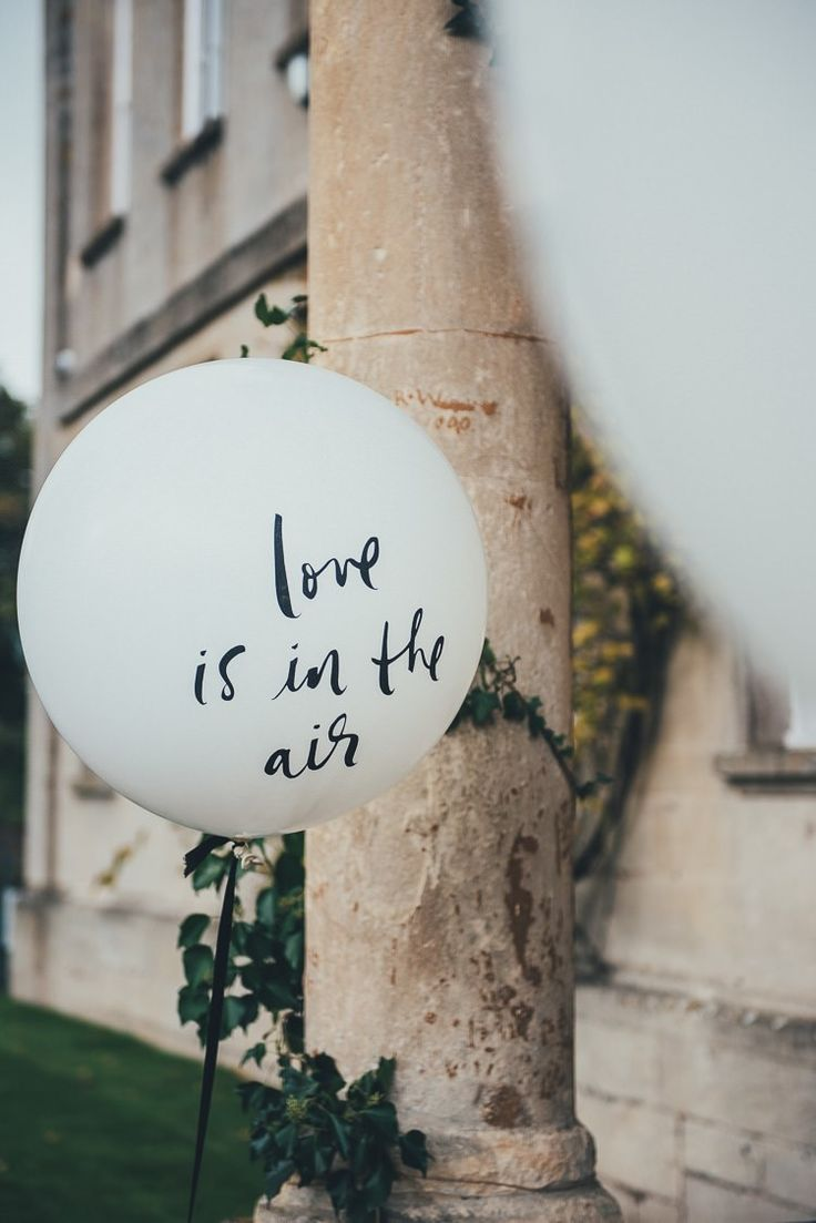 Giant Kate Spade balloons with sweet sayings add unexpected accents.