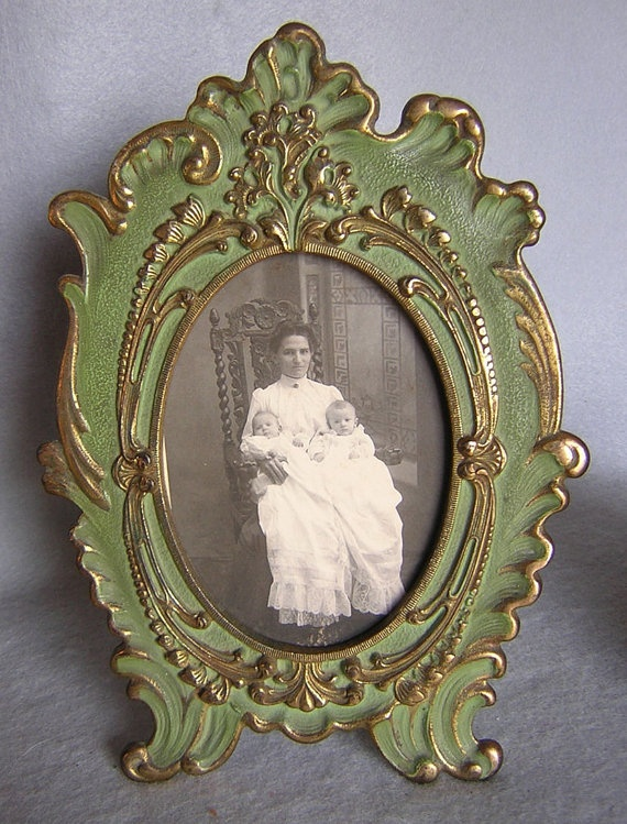 I can definitely see myself jumping on the antique picture frame collage bandwagon, but what I really want is a rocking chair like the one in this old photo!!!