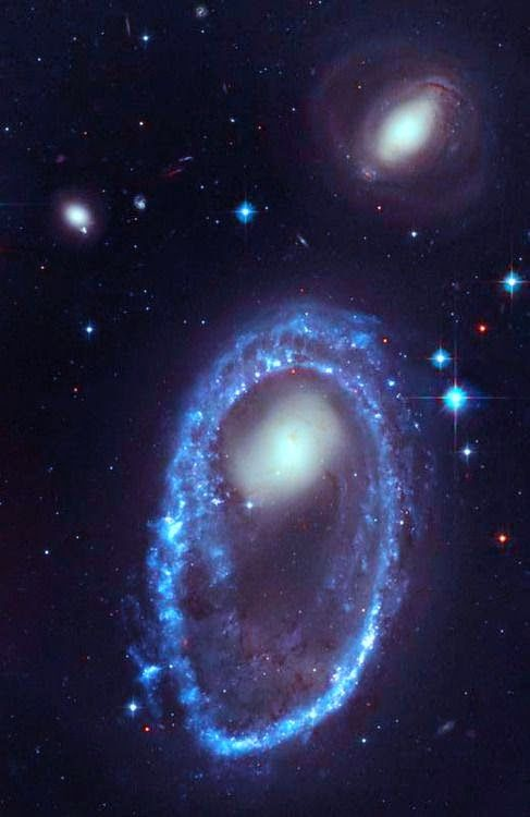 STARS bracelet  The core of the galaxy Blue Stars .Parecido AM 0644-741- a diamond-encrusted bracelet, a ring of brilliant blue star clusters wraps around the yellowish nucleus which was once a normal spiral galaxy. This image Credit: Hubble Space Telescope NASA