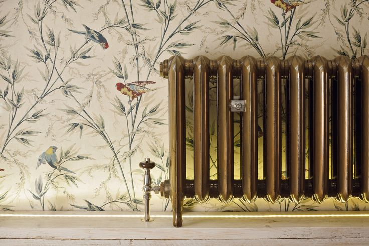 The Castrads Princess 560mm cast iron radiator in Aged gold with Windsor polished nickel thermostatic radiator valves. Full of historical nostalgia.