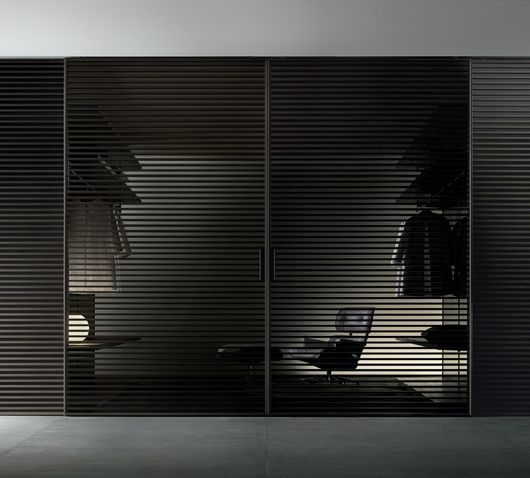 """Stripe"" Sliding Door by Rimadesio.  Brown aluminium structure and grey transparent glass."