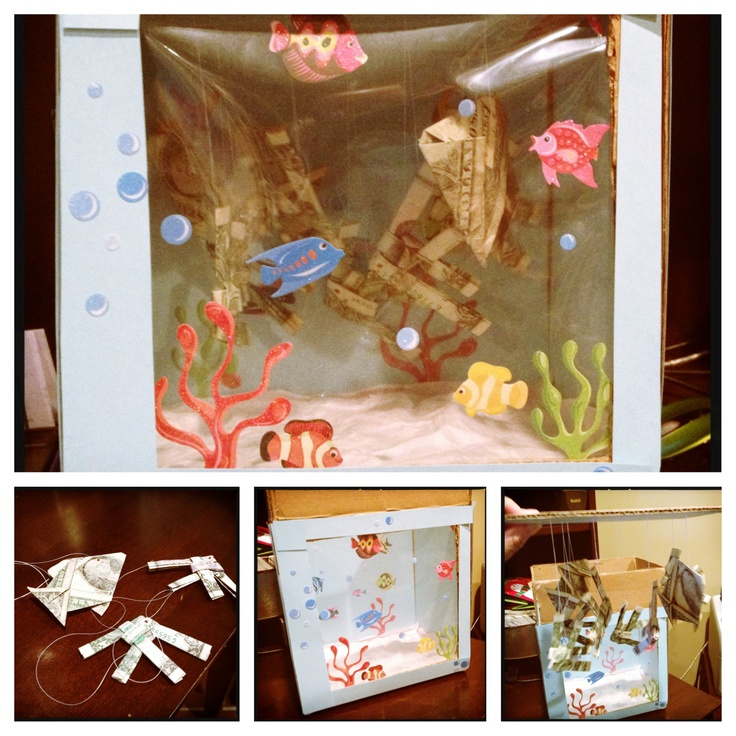 Money fish tank. Origami folded money fish in a cardboard ... - photo#35