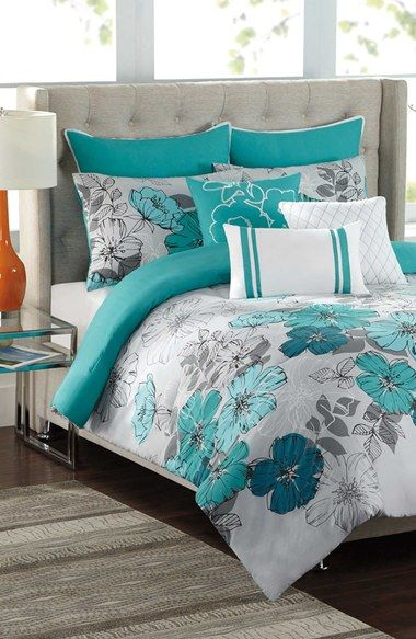 Beautiful teal bedding with soft gray accents. loving that headboard!