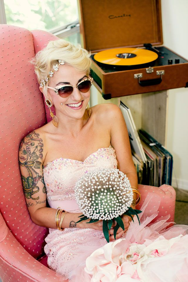 Love seeing brides (and grooms) step outside the box and do something with a little funk such as this bride in a pink dress.