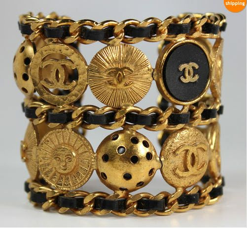 Vintage leather cuff bracelet, chanel logo.  Black & Gold-recognized several buttons on my suits!