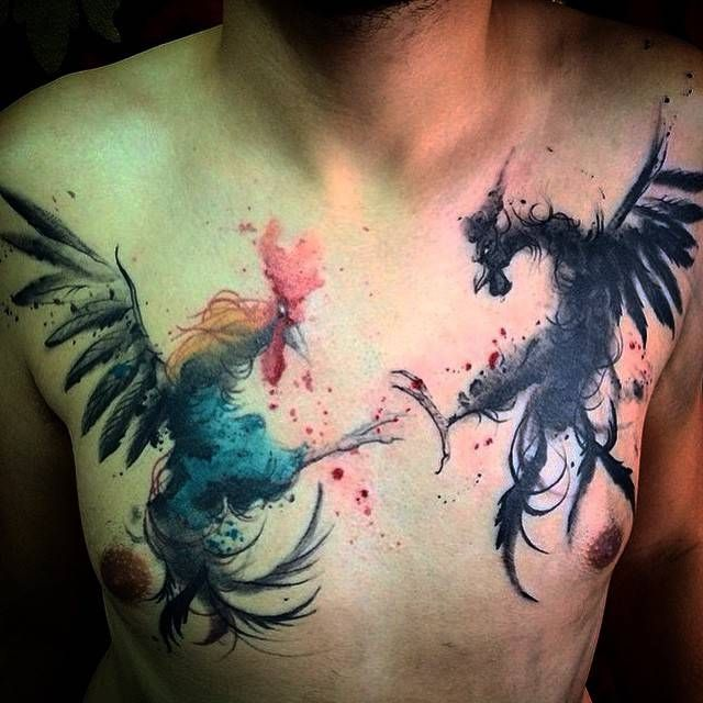 Watercolor style cockfight tattoo on the chest. By Victor Octaviano.