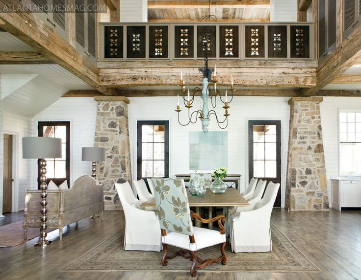 A five-foot-wide table, perfect for entertaining large groups, serves as a strong anchor in the dining area.