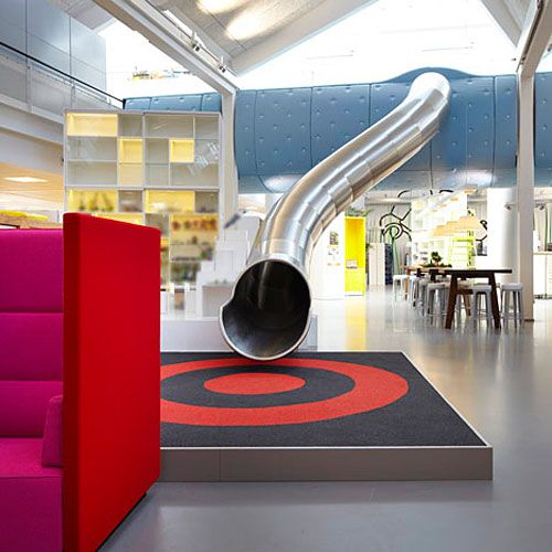The Denmark design office of LEGO has a slide in it.