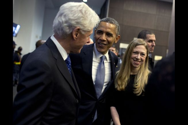 President Obama greets President Bill Clinton and his daughter Chelsea who were in South Africa for Nelson Mandela's memorial service.