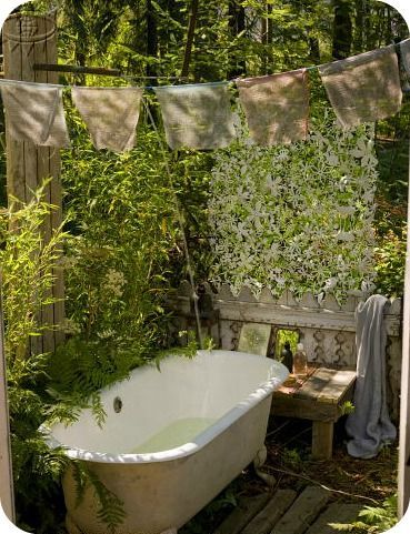 I don't know about the rest of you Pinner's,I just think it looks SO TACKY to see a Bathtub anywhere outside,and not in a Garden!!!:(