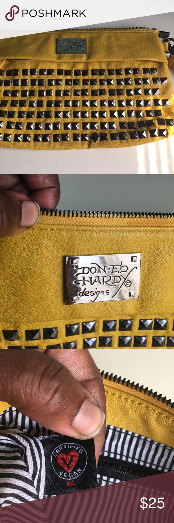 Don Ed Hardy yellow clutch w/wrist strap Ed Hardy, certified Vegan leather, yellow clutch with pewter square pewter studs.  No tears, stains or rips, one mark note Pic #7 in excellent condition in and out!  The mustard color is very stylish and eye catching. Ed Hardy Bags Clutches & Wristlets