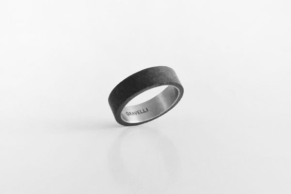 CONCRETE RING by Tomas Vacek studiovacek.cz  The new Gravelli collection of concrete jewelry is an example of modern use of concrete  as an aesthetic material. Gross industrial nature of the used materials  gets to contrast  with the detailed craftsmanship processing that creates from each piece an elegant  and inimitable original. In the collection is possible to choose from a variety of rings  and earrings in shade of cement grey and anthracite.    designed for www.gravelli.com