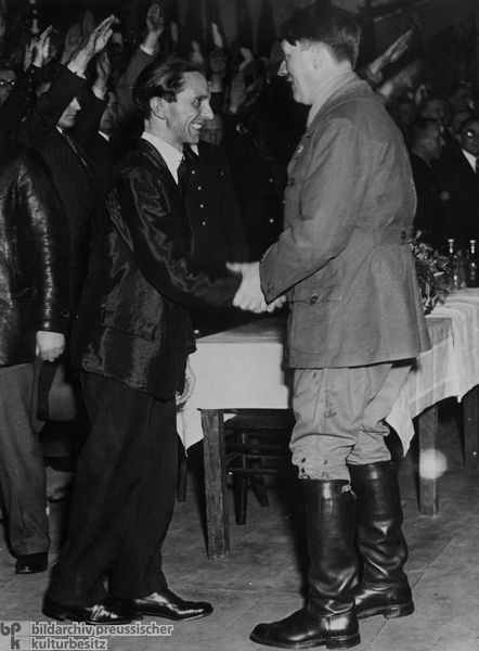 Berlin Gauleiter Joseph Goebbels greets Adolf Hitler at a campaign event in Berlin (January 20, 1933).
