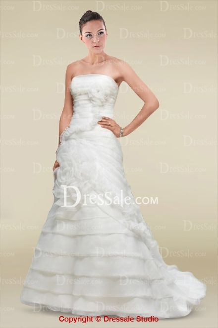 Elegant A-line Wedding Gown with Tiered Details and Floral Embellishment
