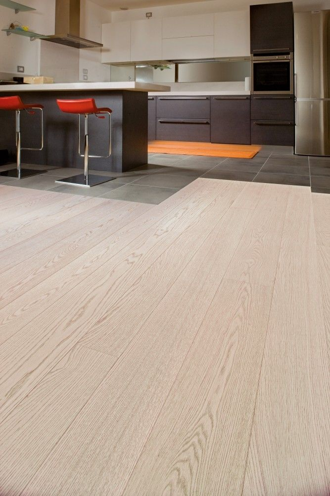 Textured Bleached White Oak FlooringThis textured bleached white oak flooring comes from Italian manufacturer Cadorin. Each plank has been brushed to remove the softer wood from the grain and add texture as well as being bleached and varnished for an almost lighter than natural oak colour. This flooring is perfect for anyone looking to add that fresh, clean look to their home.