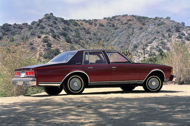 77 Chevrolet Caprice Classic. I dropped my down on reversed Cragars with white walls and had a huge system in the back