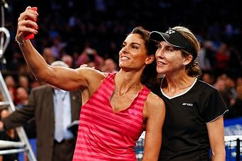 Gabriela Sabatini of Argentina and Monica Seles of the United States pose for a selfie during the BNP Paribas Showdown at Madison Square Garden on March 10, 2015 in New York City.