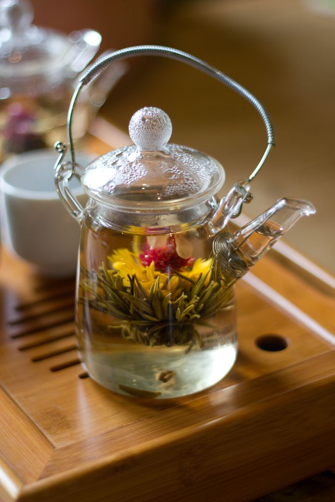 blooming (flowering) tea in a clear glass teapot