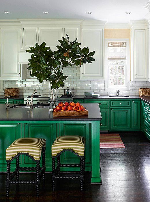A strong, happy green just seemed right and provided a contrast to the white upper cabinets, subway tile, and marble of this gorgeous Texas kitchen