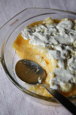 Mămăligă Cu Smăntănă (Romanian Polenta with Sour Cream)_ This polenta-like pudding, a staple across Romania, has a firm texture and a briny flavor from a salty, feta-like cheese mixed in at the end of cooking. A topping of more cheese and sour cream makes this a satisfying side dish. This recipe first appeared in our March 2012 issue with Alexander Lobrano's article Eternal Terrain.
