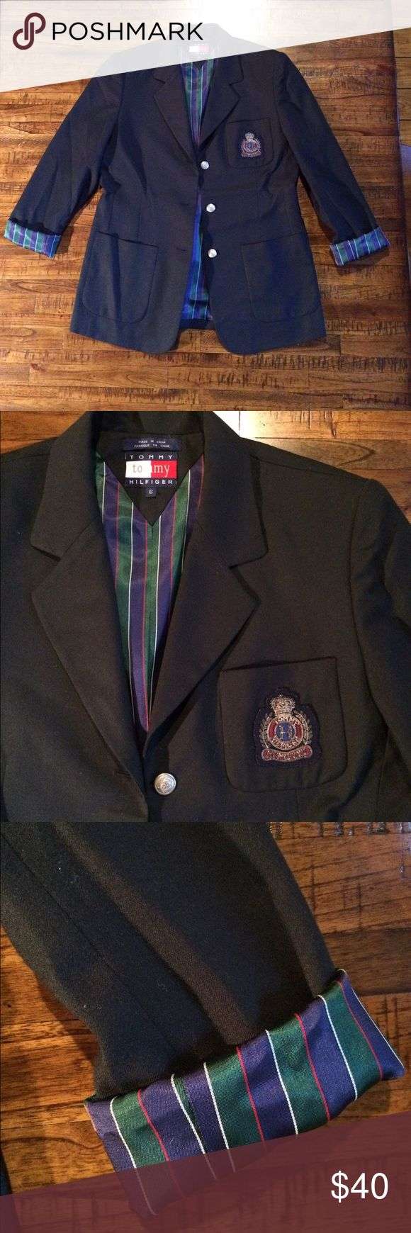 Gossip Girl Prep Blazer You don't see a lot of blazers like this! Looks like it came straight out of the show Gossip Girl! Excellent condition navy blue blazer with satin striped lining (which you can show off when you roll the sleeves) and metal buttons down the front. Has a collegiate patch to round out the prep look. Measures 16 in across shoulders, 18.5 in across bust, 28 in length from back of collar, and 24 in sleeve length. Size 6 Tommy Hilfiger Jackets & Coats Blazers
