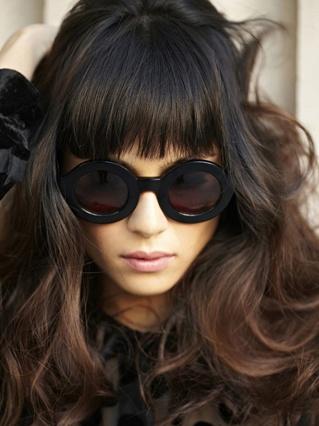 awesome shades. full BANGS! wavy hair.