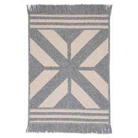 Braided and reversible wool-blend rug with a Southwestern motif and fringe trim. Made in the USA.  Product: RugConstruction Material: 65% Polyester and 35% woolColor: GrayFeatures:  Made in the USABraidedReversible Note: Please be aware that actual colors may vary from those shown on your screen. Accent rugs may also not show the entire pattern that the corresponding area rugs have.Cleaning and Care: Vacuum with hard surface attachment only. Spot clean with any common household cleaner