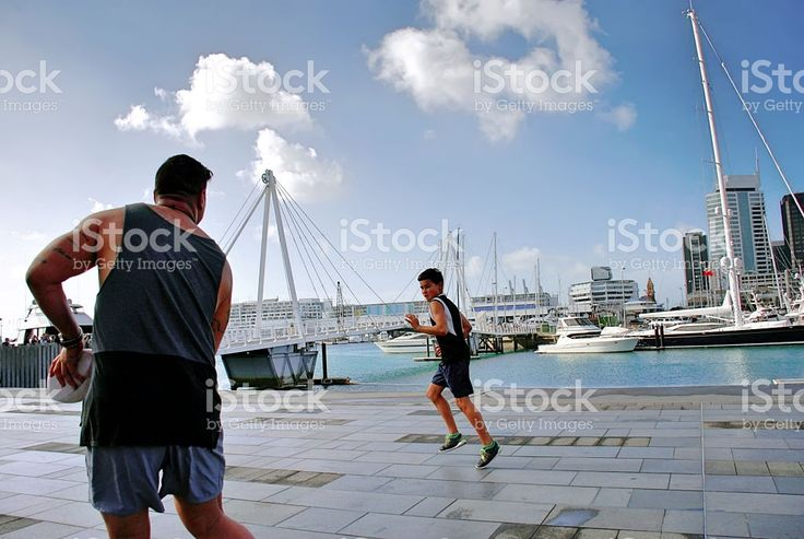 Playing Rugby against an Urban Auckland Scene, New Zealand royalty-free stock photo