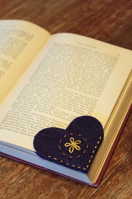 Felt heart bookmark: Cut two heart shapes. Embroider a pattern on one. Sew together along the straight edges.
