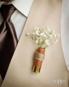 Shotgun Shell Boutonniere - just showing concept - ours would be some combination of Blue Thistle,  Peach Hypericum, Seeded Eucalyptus & or Dusty Miller. Perhaps Thistle for Groom, Hypericum for Groomsmen?