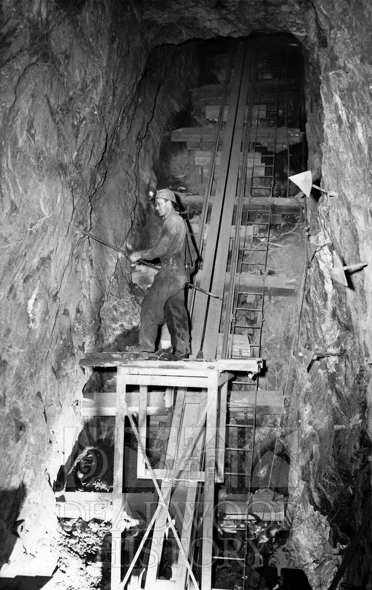 A Mine Employee Works Along The Incline Raise Between The