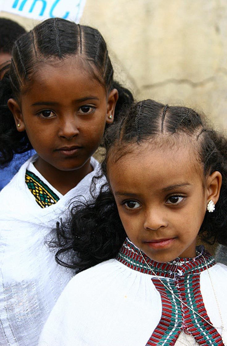 Africa | Asmara children with traditional hairstyles. Dressed for the National Day celebrations. Asmara, Maekel, Eritrea | ©Eric Lafforgue