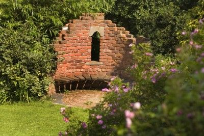 brick and stone wall with bench garden folly from tathamfells.me.uk