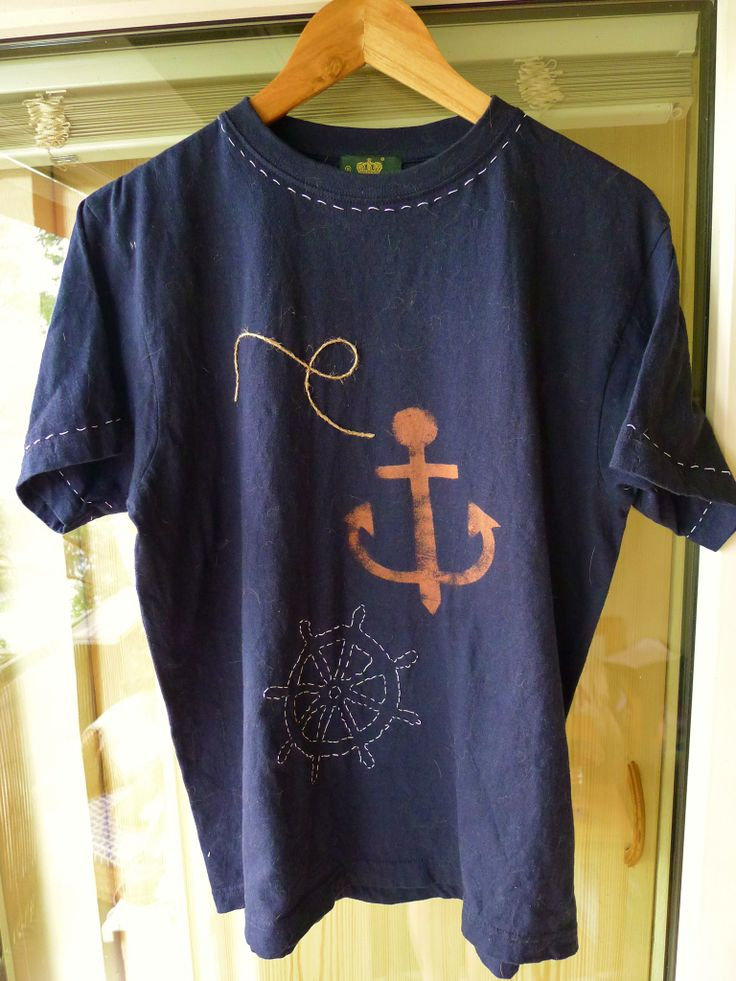 an inexpensive t-shirt embellished with some bleach and running stitch