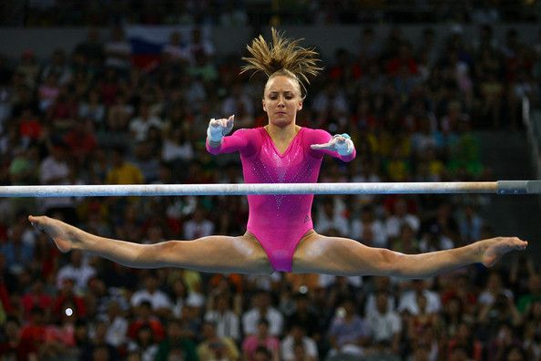 Nastia Liukin of the United States competes on the uneven bars in the artistic gymnastics event at the National Indoor Stadium on Day 7 of the Beijing 2008 Olympic Games on August 15, 2008 in Beijing, China.