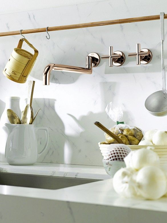 The Emerging Design Trends You Need to Know About// Modern white kitchen with rose gold fixtures