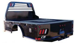 "Action customizes CM SK Model Truck Beds- The SK  features an angled fuel fill, rear bed corners tapered for turning radius, rear bumper with aluminum tread plate trim, side rub rails with stake pockets, removable 4"" tall side rails, and a full access receiver mount. For more information regarding the CM line of hauler bodies please call our sales team at 800-330-1229 Registering for Action emails is so simple, just text ACTIONTRUCK to 42828. *Message and data rates may apply."