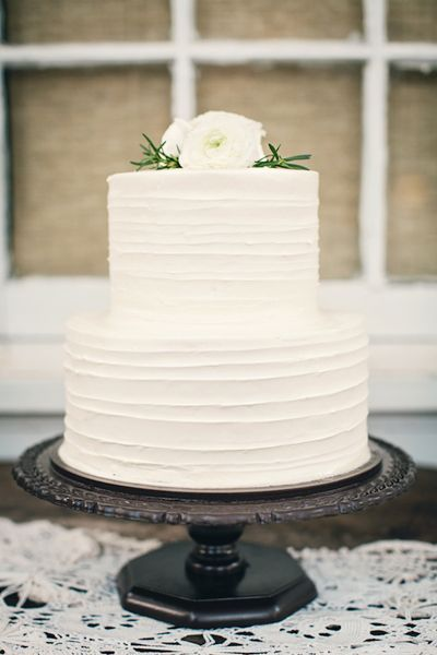 Simple white wedding cake with white flowers on top! Simplicity is sometimes the most elegant option.