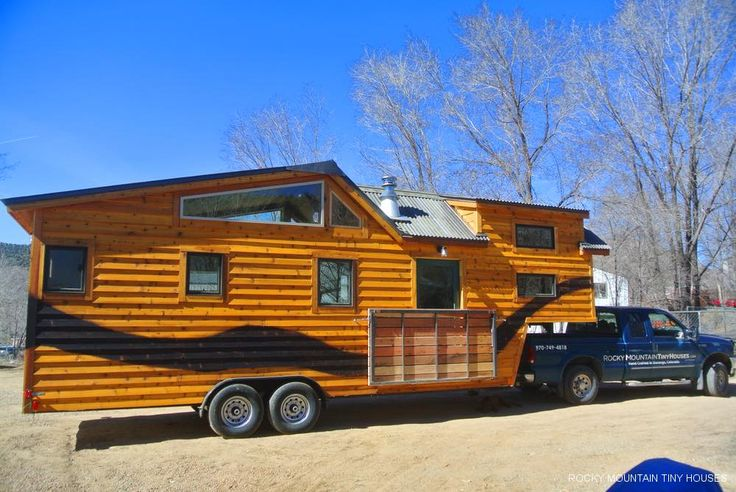 This custom32′ gooseneck trailer tiny house on wheelswas built by Greg Parham, of Rocky Mountain Tiny Houses, for a family of three (husband, wife, toddler, plus a dog and a cat). The family want...