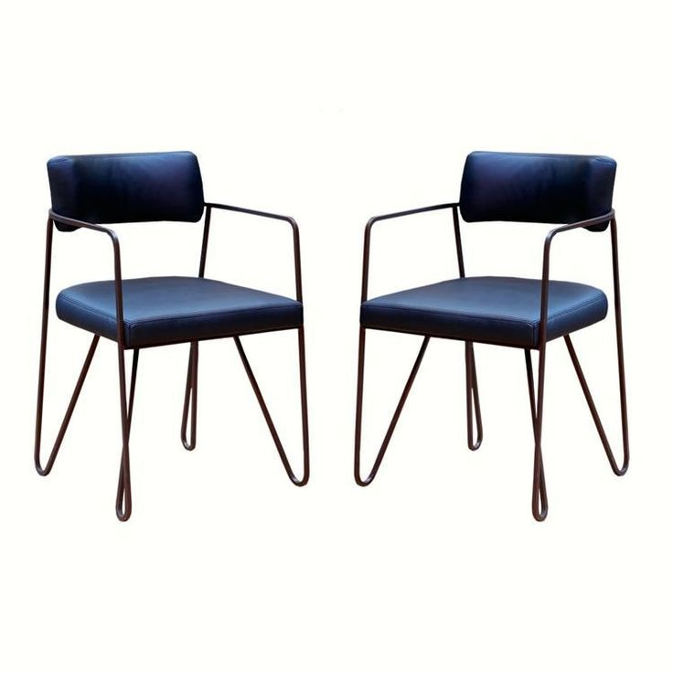 """Wire Dining Chairs - Pair. Industrial chic and comfort meet effortlessly on this contoured pair of chairs. Features black leather seats and an iron frame.  Dimensions:  21""""W x 22""""D x 33""""H   Seat Height:   20"""" Arm Height:   27.5""""  Material : Iron Frame and Fabric Seat."""