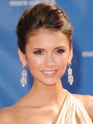Nina Dobrev: beautiful fresh faced make up, gorgeous earings, and a classy up-do... she always looks beautiful