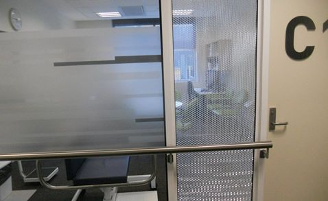 Airboard metal panels - decorative glazing panels for doors.