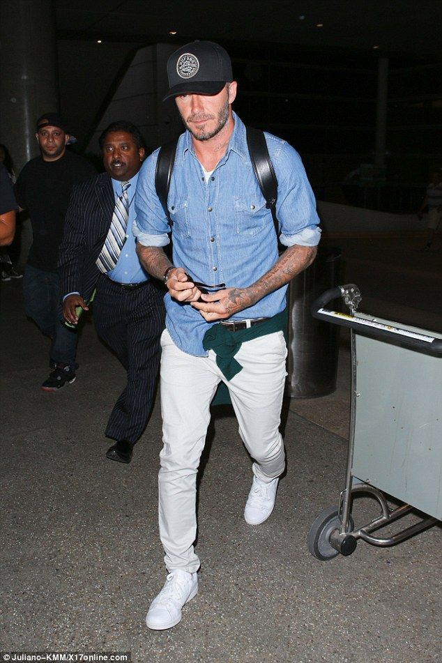 Back in LA! David Beckham returned back to LAX on Saturday following a brief trip to England to watch his friend Guy Ritchie tie the knot