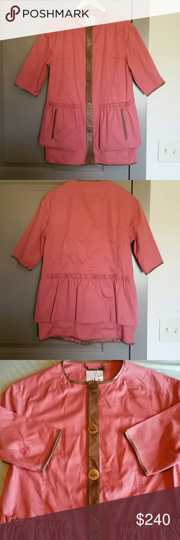 "Tibi Pink Cotton/Leather Jacket size 2 Beautiful dark salmon color with brown leather trim around neck, sleeves, pockets and lock closures. Ruffles top front pockets and accent back. Measures approximately 20"" from pit to pit, 33"" from collar to bottom hem, 13"" sleeves. Tibi Jackets & Coats"