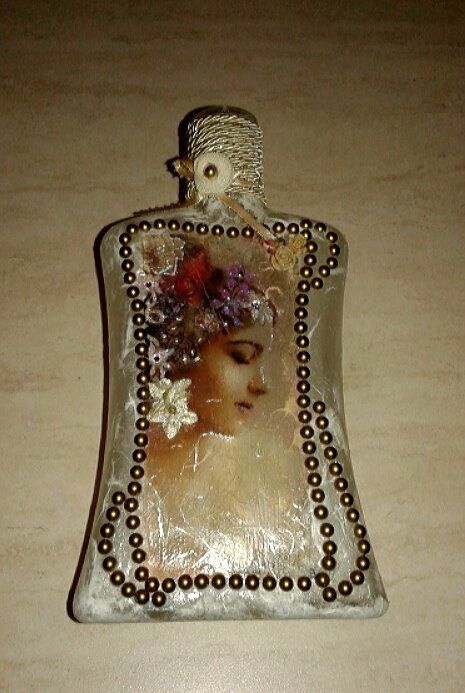 Decoupaged bottle with rise paper ,decorated with stras , fake flowers and ribbon