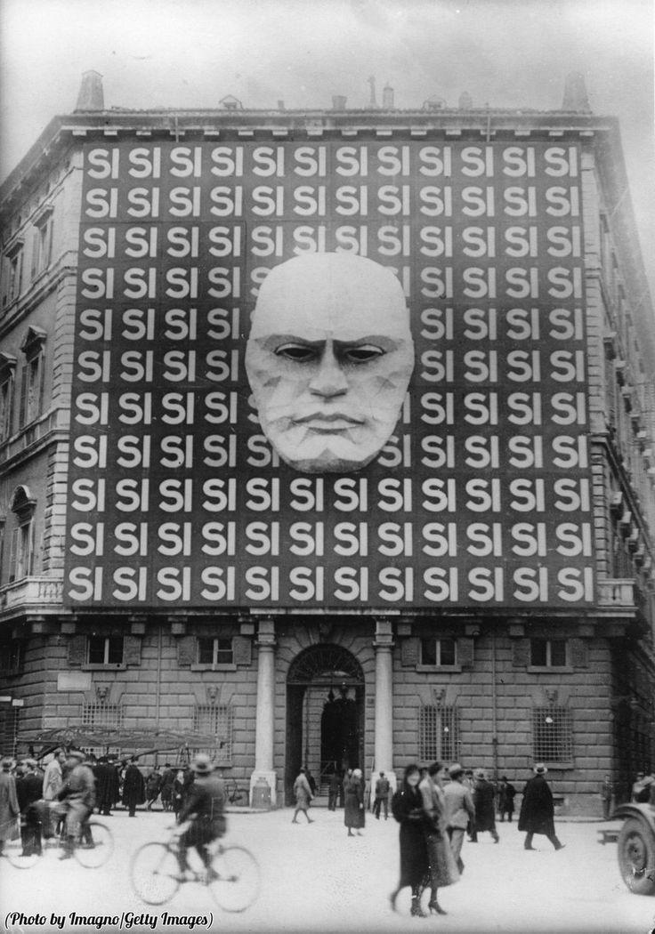 Propaganda on the facade of Benitto Mussolini's headquarters in the Palazzio Braschi. Rome, 1934