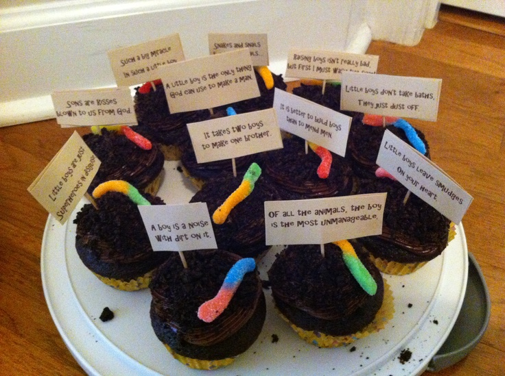 Dirt cake cupcakes for baby boy sprinkle.  Cute little boy sayings for the toppers.