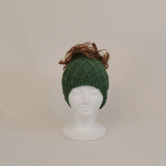 This green beanie hat with a ponytail hole is great if youre like me and dont want to take your hair down to put on a hat. It acts as a very #beanie #headband #hole #ponytailhat #ponytail #knit #green #hat