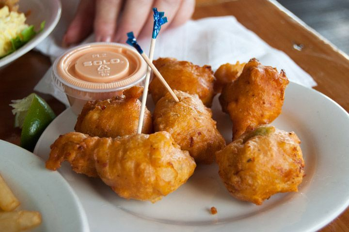 Conch Fritters are sold all throughout the Bahamas where conch is the national food. This recipe gives you the authentic Bahamian experience… when you bite into these golden, crispy fritters, you'll find tender conch mollusk meat paired with fresh veggies and spices. Try them with the simple creamy-hot sauce, or your own sauces of choice. Get the recipe at http://tastetheislandstv.com/conch-fritters/. #Bahamas #seafood #islands #foodie #paradise #nomnom #recipes #caribbeanfood…